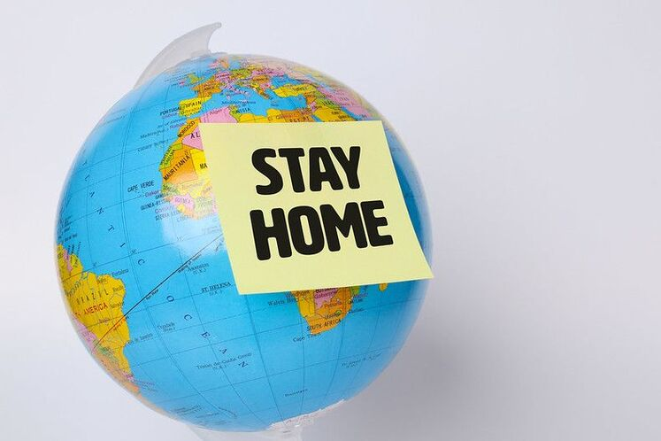 A world globe saying stay at home while Rollin Delivery and Errands runs your errands