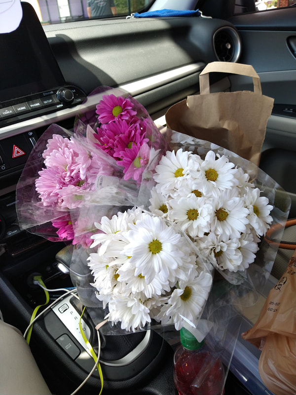 Four bouquets of flowers from Harris Teeter being delivered with grocery by RollinDelivery.com